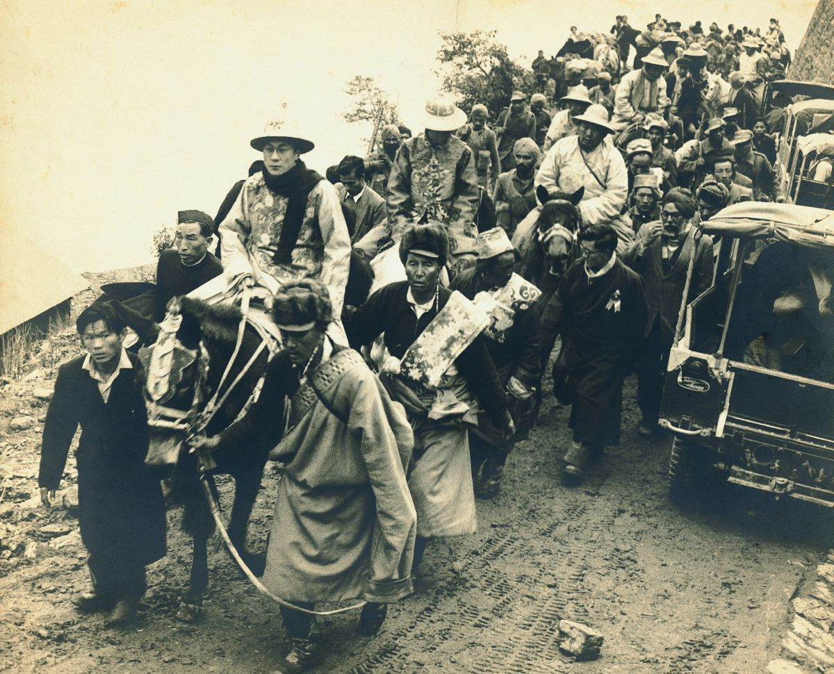 The young Dalai Lama crossing into India through the Nathu La Pass, in 1956
